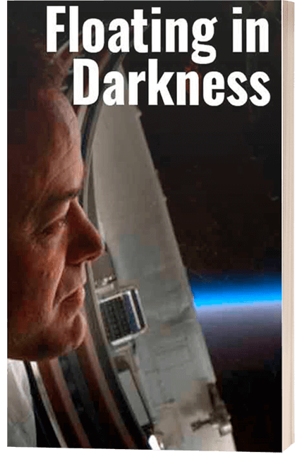 floating in darkness book cover by author ron garan